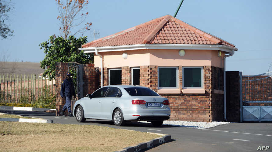 A car carrying elders of the Mandela family is seen outside the former state president's home in Qunu on June 25, 2013.