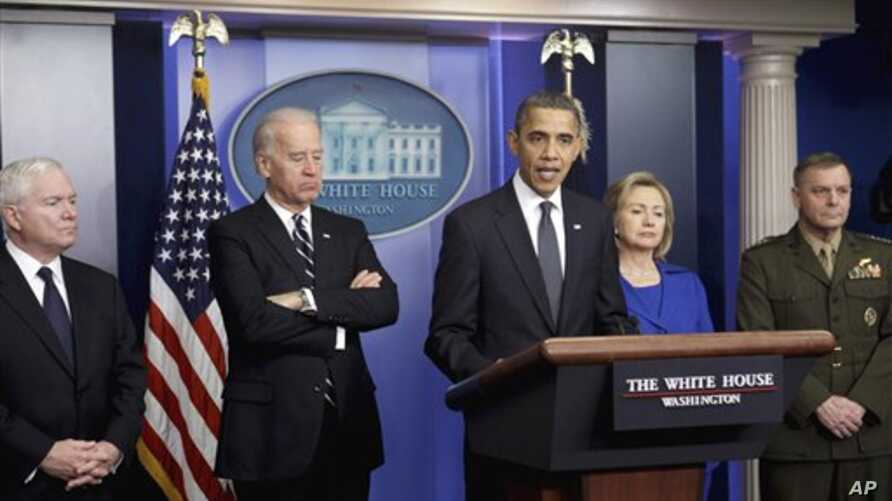 President Barack Obama delivers a statement in the White House Dec. 16, 2010, on the the Afghanistan-Pakistan Annual Review. From left are, Defense Secretary Robert Gates, Vice President Joe Biden, the president, Secretary of State Hillary Rodham Cli