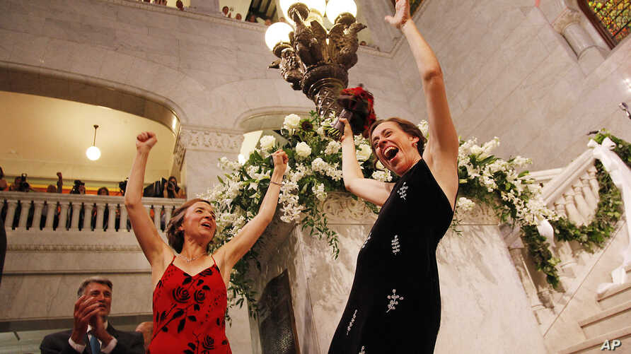 Margaret Miles, right, celebrates with wife Cathy ten Broeke, left, after they were married at the Minneapolis Freedom to Marry Celebration and Weddings, Aug. 1, 2013 at the Minneapolis City Hall.