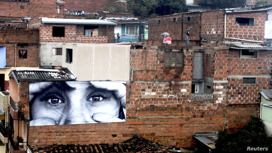 A picture is seen on the roof of a house in a neighborhood of northeast Medellín, Colombia, Jan. 30, 2012.