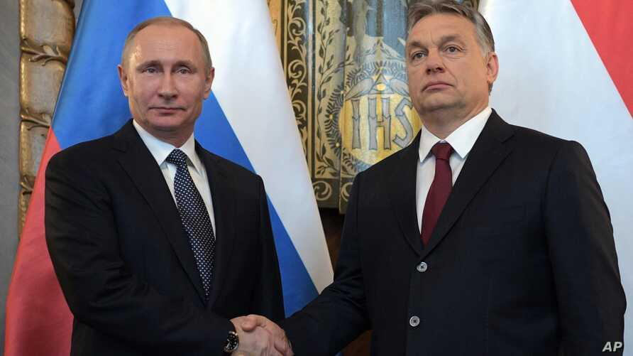 Russian President Vladimir Putin, left, shakes hands with Hungarian Prime Minister Viktor Orban during their meeting in Budapest, Hungary, Feb. 2, 2017. Putin's visit to Hungary is his first trip to the European Union since the U.S. presidential elec