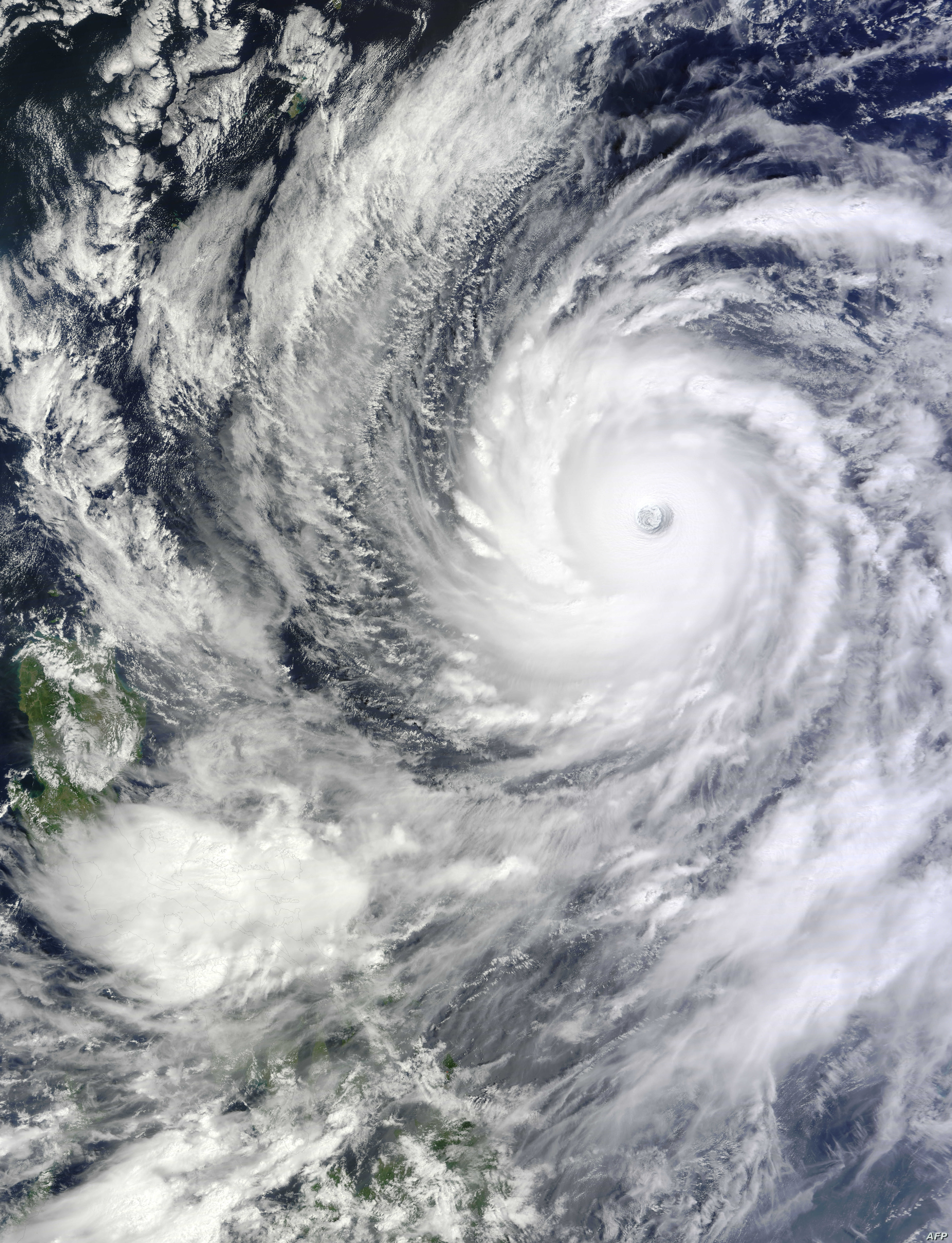 NASA satellite image shows Typhoon Vongfong in the western Pacific Ocean. Typhoon Vongfong is rapidly intensifying and is a dangerous threat to Japan this weekend, Oct. 8, 2014.