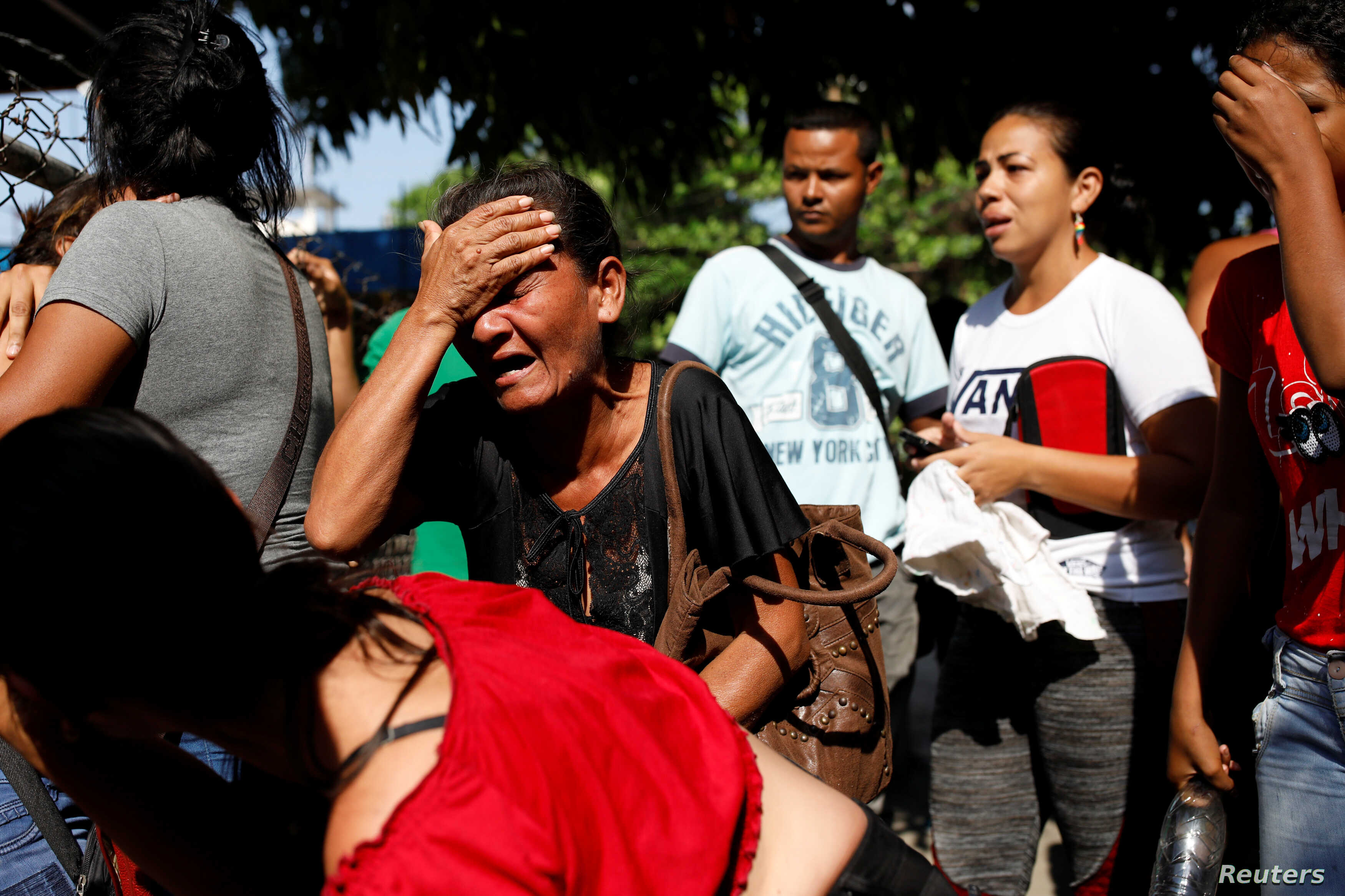 Relatives of inmates at the General Command of the Carabobo Police react as they wait outside the prison in Valencia, Venezuela, March 28, 2018.