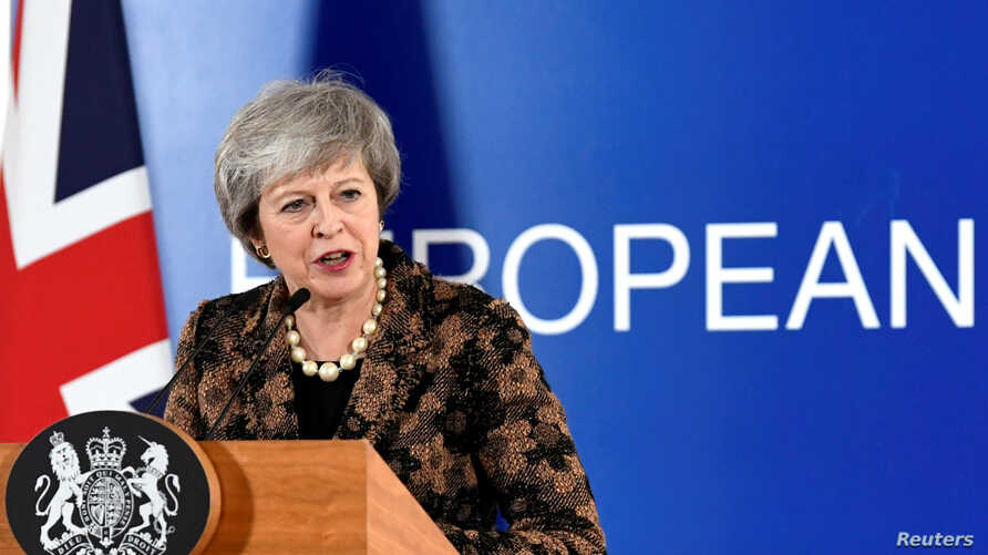 British Prime Minister Theresa May attends a news conference after a European Union leaders summit in Brussels, Belgium, Dec. 14, 2018.