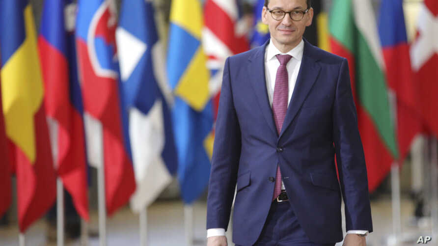 FILE - A Dec. 14, 2017 file photo showing Polish Prime Minister, Mateusz Morawiecki, arriving for an EU summit at the Europa building in Brussels. Poland's new prime minister is looking to improve strained relations with partners in the European Unio