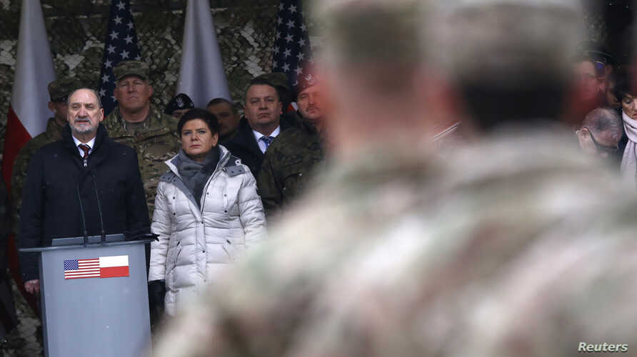 Polish Defense Minister Antoni Macierewicz (L) and Prime Minister Beata Szydlo attend an official welcoming ceremony for U.S. troops deployed to Poland as part of NATO build-up in Eastern Europe, in Zagan, Poland, Jan. 14, 2017.