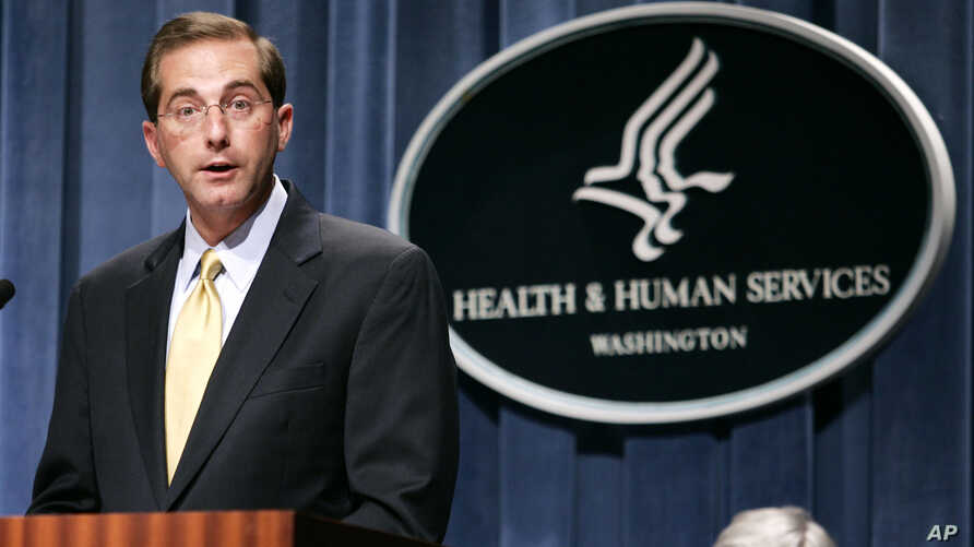 FILE - Then-Deputy Health and Human Services Secretary Alex Azar meets reporters at the HHS Department in Washington, June 8, 2006 to announce the approval of Gardasil, first vaccine developed to protect women against cervical cancer.