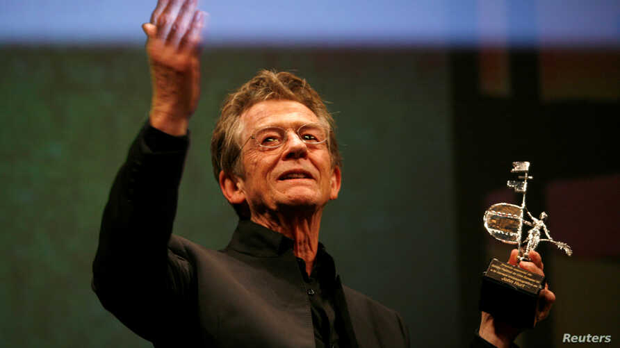 FILE - British actor John Hurt holds the Gold Giraldillo Award as a tribute to his career during the Sevilla European film festival in the Andalusian capital of Seville, Nov. 7, 2009.