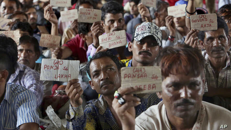 Released Indian fishermen display their name tags at a railway station to leave for their homeland, in Karachi, Pakistan, April 7, 2019.