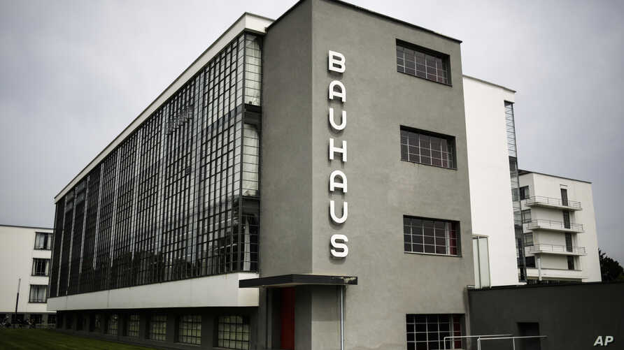 This June 27, 2017 photo shows the Bauhaus main building in Dessau, Germany. The Bauhaus World Heritage is to be extended to include the Houses with Balcony Access on the Dessau-Toerten housing estate and the ADGB Trade Union School.