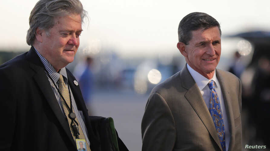 U.S. National Security Advisor Michael Flynn (R) and Senior Counselor Steve Bannon board Air Force One at West Palm Beach International airport in West Palm Beach, Florida, Feb. 12, 2017.