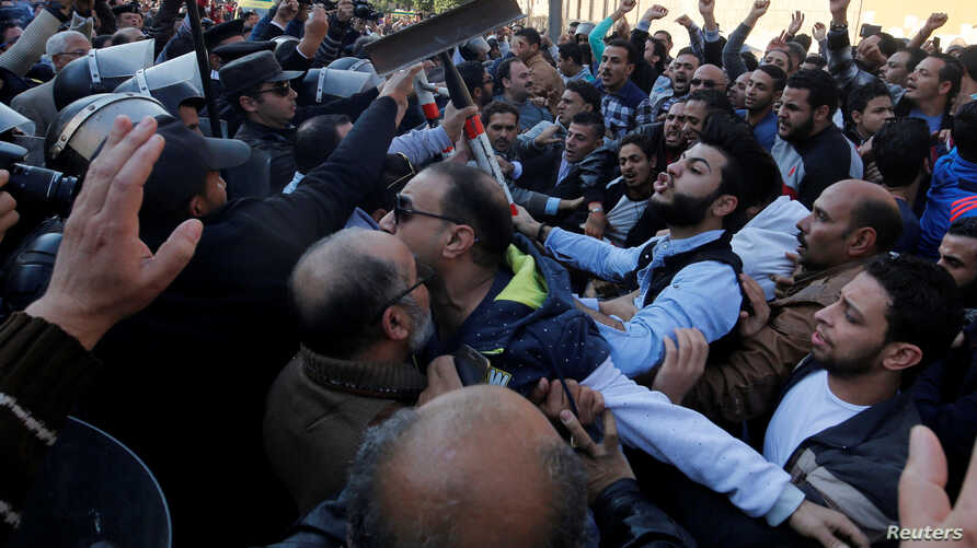Christians clash with riot police in front of Cairo's Coptic Cathedral after an explosion inside the cathedral in Cairo, Egypt, Dec. 11, 2016.