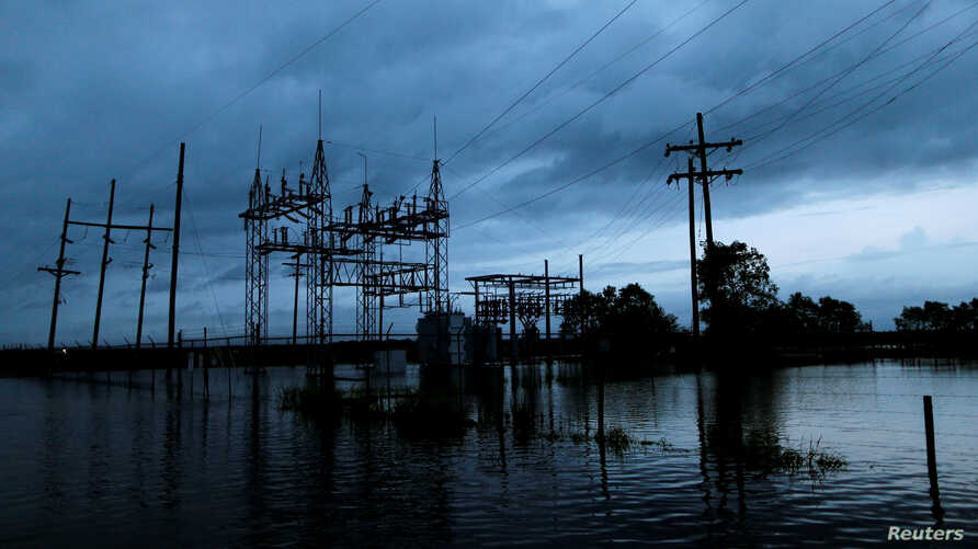 Flood waters from Tropical Storm Harvey surround a power sub-station in Iowa, Calcasieu Parish, Louisiana, Aug. 29, 2017.