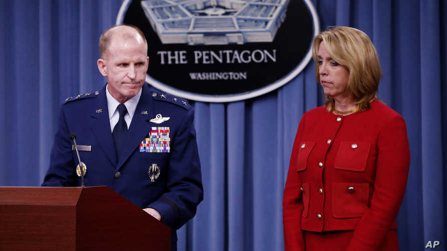 Air Force Secretary Deborah Lee James and Air Force Global Strike Command (AFGSC) Commander Lt. Gen. Stephen Wilson, finish their statements before taking questions during a news conference at the Pentagon, Thursday, March 27, 2014
