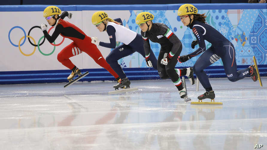From left, Li Jianrou of China, Elise Christie of Britain, Arianna Fontana of Italy and Park Seung-hi of South Korea start in a women's 500m short track speedskating final at the Iceberg Skating Palace during the 2014 Winter Olympics in Sochi, Russia