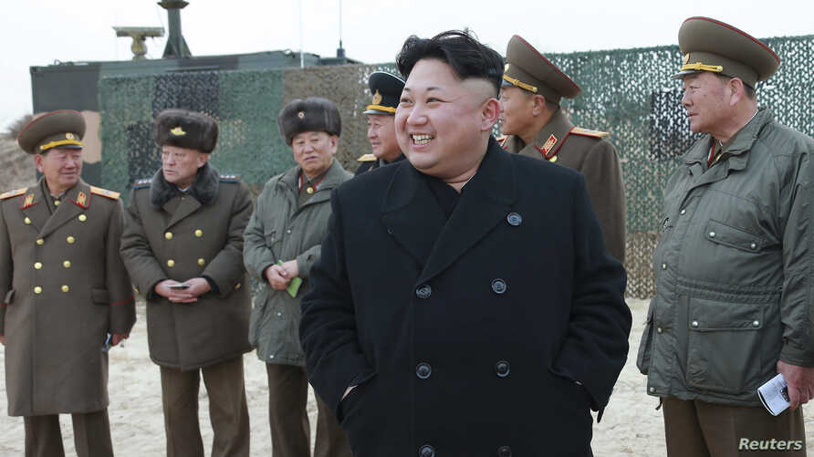 North Korean leader Kim Jong Un guides a rocket-launching drill in this undated photo released by the Korean Central News Agency in Pyongyang, Dec. 30, 2014.