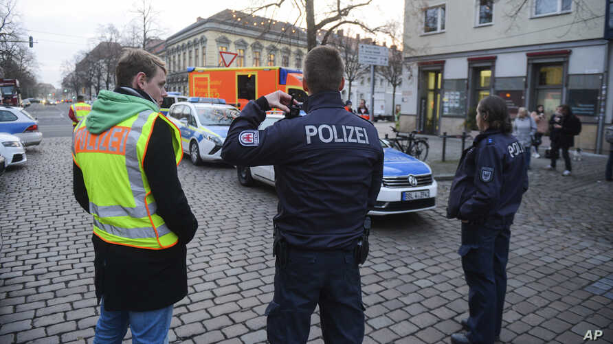 Police close the streets around a Christmas market after a suspicious object was found in Potsdam, eastern Germany, Friday, Dec. 1, 2017.