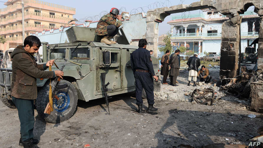 Afghan security forces inspect the site of an attack by Islamic State militants at the British charity Save the Children compound in Jalalabad on Jan. 25, 2018.