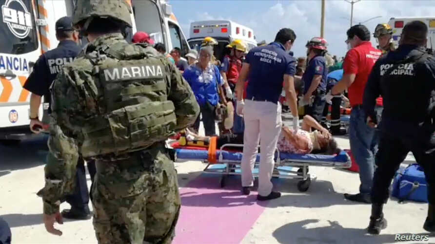 Emergency crews at the scene of an explosion at Playa del Carmen, Quintana Roo, Mexico, Feb. 21, 2018,
