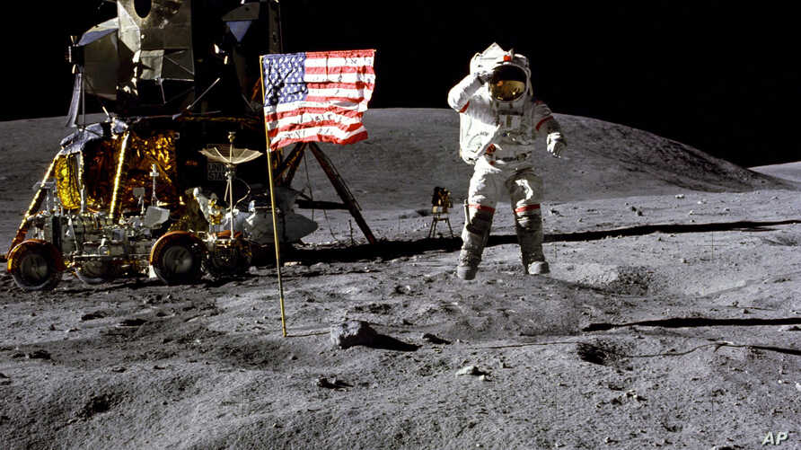 In this April 1972 photo made available by NASA, John Young salutes the U.S. flag at the Descartes landing site on the moon during the first Apollo 16 extravehicular activity.