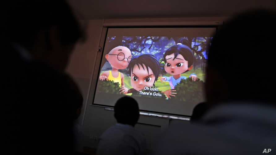 Pakistani orphans watch an early screening of the first episode of the animate Burka Avenger Series, at an orphanage on the outskirts of Islamabad, Pakistan, March 25, 2013.
