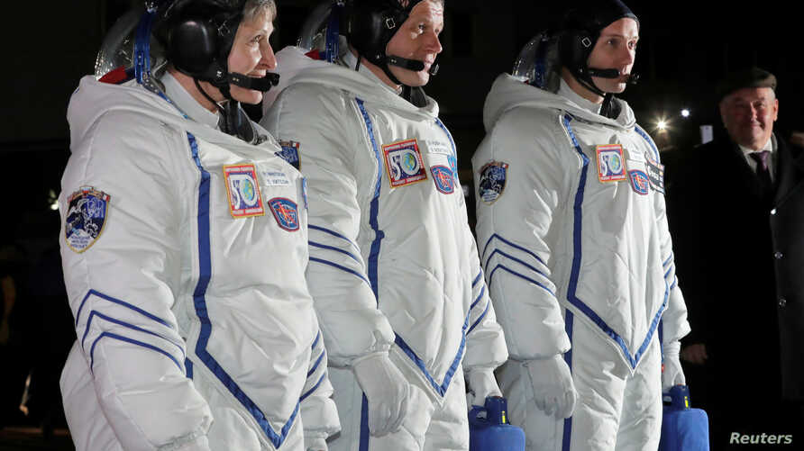 The International Space Station crew members, from left, American Peggy Whitson, from left, Russian Oleg Novitskiy and Frenchman Thomas Pesquet are seen before the launch of the Soyuz spacecraft at the Baikonur cosmodrome, Kazakhstan, Nov. 17, 2016.