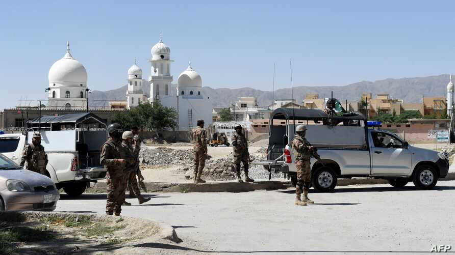 Pakistani soldiers stand guard at the site where Chinese missionaries was kidnapped in the neighborhood of Jinnah town in Quetta on May 24, 2017.