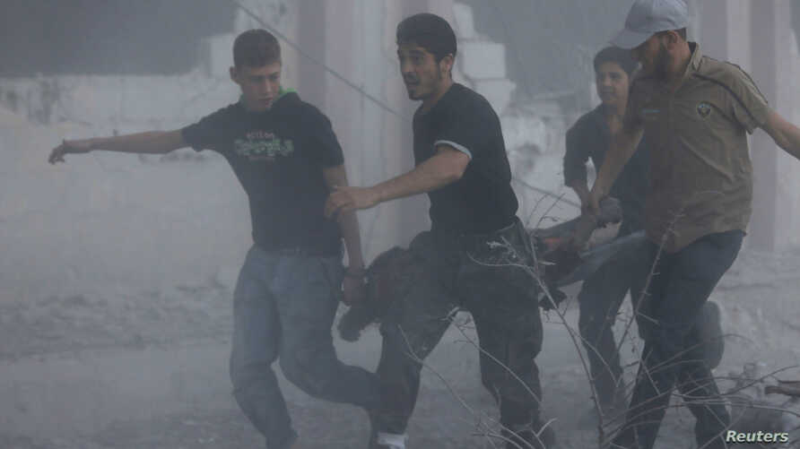 Men transport a casualty at a site hit by what activists said were airstrikes by forces loyal to Syria's President Bashar al-Assad, in the Duma neighborhood of Damascus, Syria, Sept. 10, 2014.
