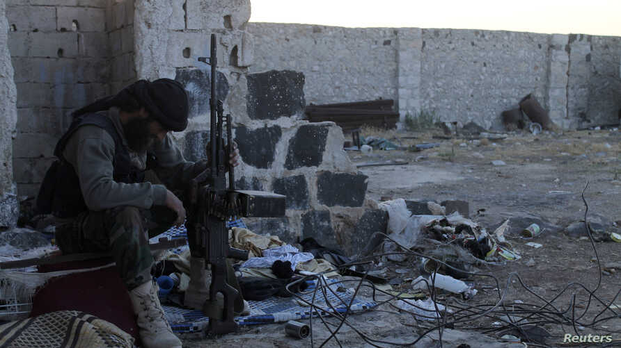 FILE - A Free Syrian Army fighter rests in an area south of Aleppo.
