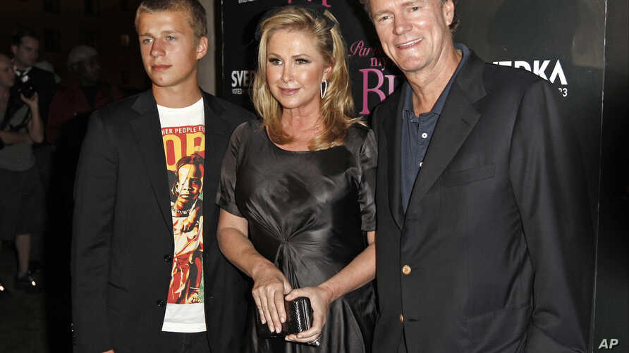 "FILE - onrad Hilton, left, Kathy Hilton, center, and Rick Hilton arrive at the launch party of new MTV series ""Paris Hilton's My New BFF"" in Los Angeles."