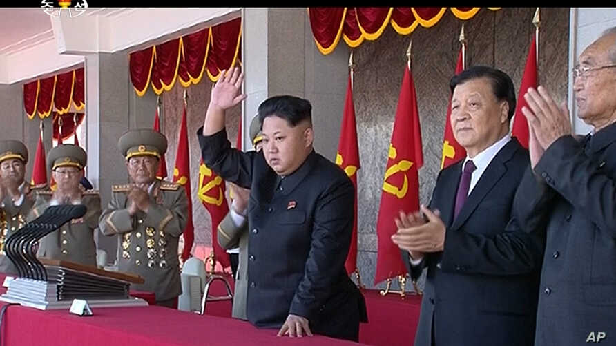 FILE - In an image made from video, North Korean leader Kim Jong Un, center, and Liu Yunshan, China's Communist Party's No. 5 leader, second right, waves during a ceremony to mark the 70th anniversary of the country's ruling party, in Pyongyang, Oct.
