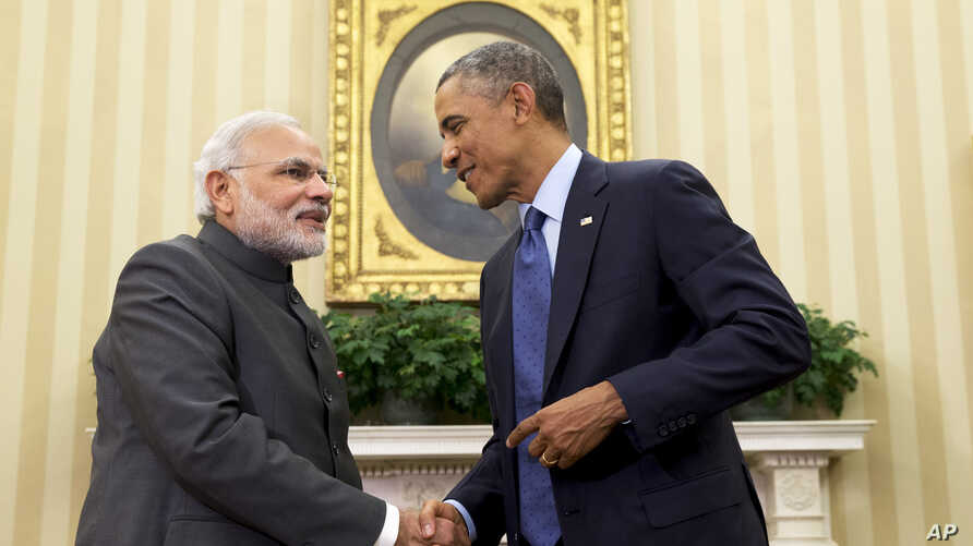 """President Barack Obama shakes hands with Indian Prime Minister Narendra Modi, Tuesday, Sept. 30, 2014, in the Oval Office  of the White House in Washington. President Barack Obama and India's new Prime Minister Narendra Modi said Tuesday that """"it is ..."""