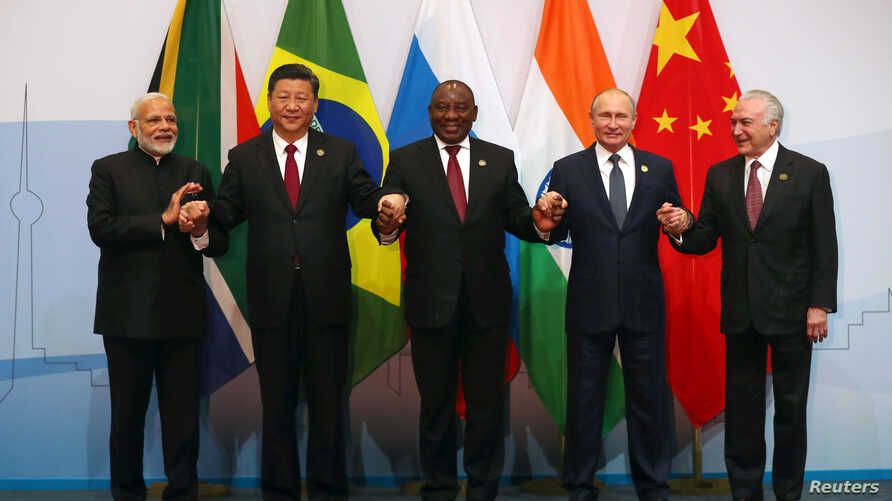 Indian Prime Minister Narendra Modi, China's President Xi Jinping, South Africa's President Cyril Ramaphosa, Russia's President Vladimir Putin and Brazil's President Michel Temer pose for a group picture at the BRICS summit meeting in Johannesburg, S