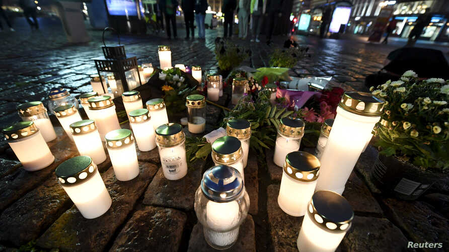 Candles at Turku Market Square for the victims of Friday's stabbings are pictured in Turku, Finland Aug. 18, 2017.