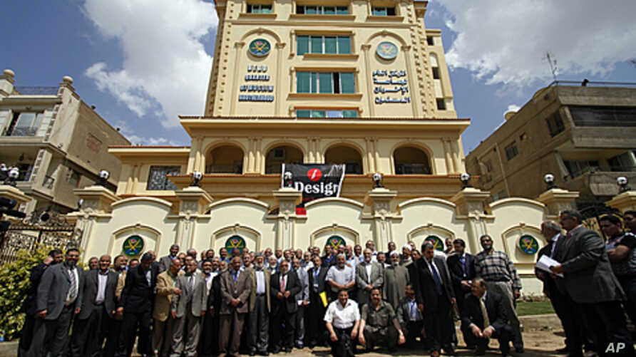 Egyptian Muslim brotherhood Shura council members gather to be photographed outside the new Muslim brotherhood headquarters in Cairo, April 30, 2011