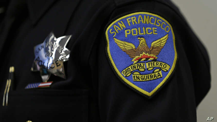 A patch and badge is seen on the uniform of a San Francisco police officer during a news conference Friday, April 29, 2016, in San Francisco.
