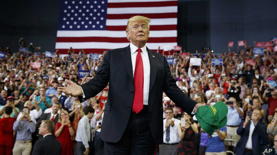 President Donald Trump arrives to speak to a campaign rally at the Ford Center, Aug. 30, 2018, in Evansville, Ind.