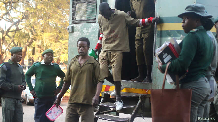FILE - Oppositon supporters arrested for violent protests arrive to submit bail applications at the Harare Magistrates Courts in Harare, Zimbabwe, August 7,2018.
