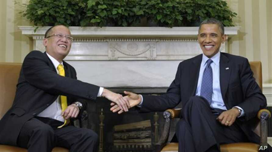 Philippines President Aquino (left) and President Obma at White House Jun 8, 2012