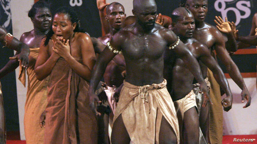 FILE - Ghanaian actors perform a show on slavery at Elmina castle in Cape Coast, March 25, 2007. One of travel company Altruvistas' trips looks at slavery in Ghana.