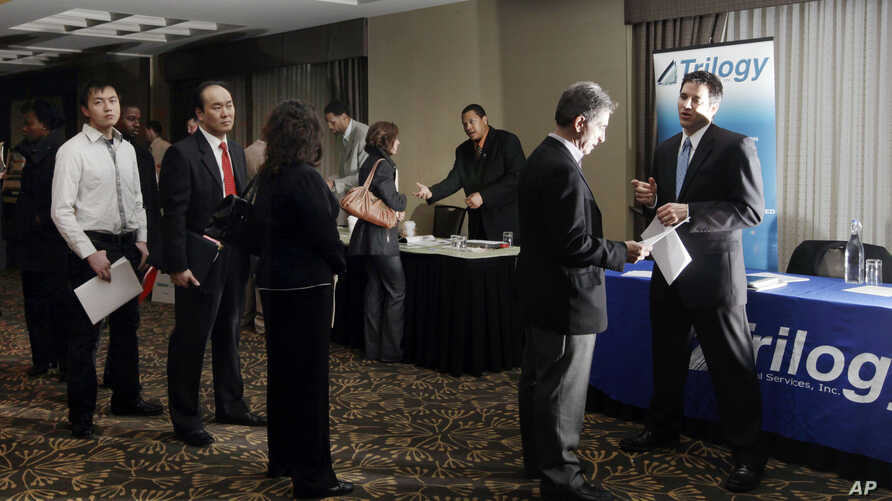 Job seekers line up at a job fair in Boston. While overall unemployment for Asian-Americans remains below the national average, their rate of long-term unemployment is the highest.