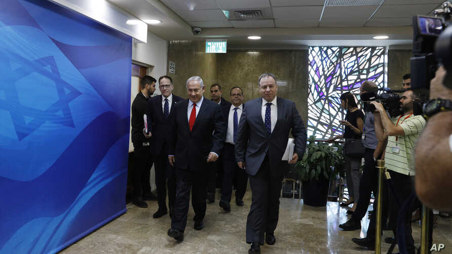 Israeli Prime Minister Benjamin Netanyahu arrives to the weekly cabinet meeting at his Jerusalem office, July 23, 2018.