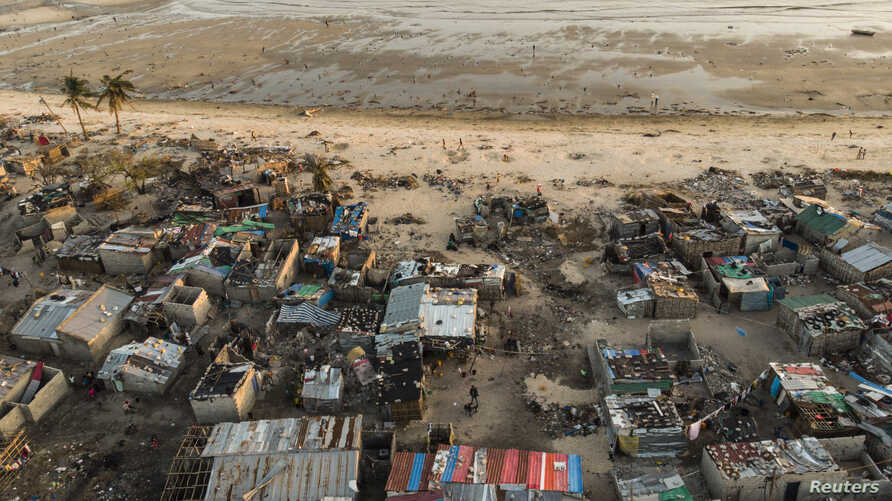 Debris and destroyed buildings are all that remain after Cyclone Idai hit the Praia Nova neighborhood in Beira on April 1, 2019.