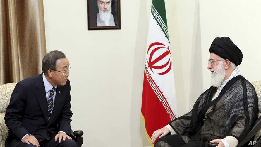 In this photo released by an official website of the Iranian supreme leader's office, U.N. Secretary-General Ban Ki-Moon, left, meets with Iranian supreme leader Ayatollah Ali Khamenei, under a portrait of late revolutionary founder Ayatollah Khomein
