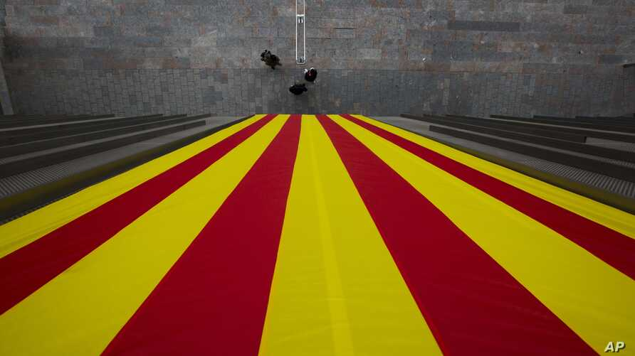 A Catalan flag hangs from a Catalan government building in Girona, Spain.