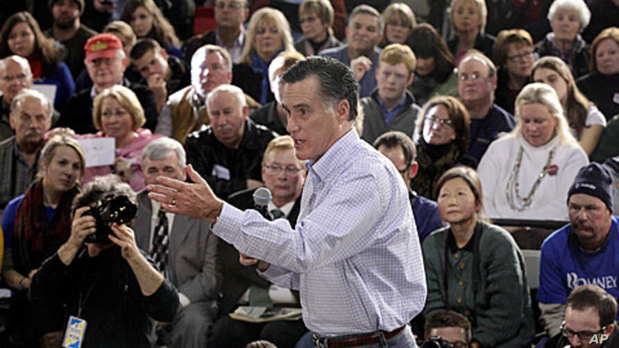 Republican presidential candidate, former Massachusetts Gov. Mitt Romney campaigns during a town hall style meeting in Manchester, New Hampshire, January 4, 2012.