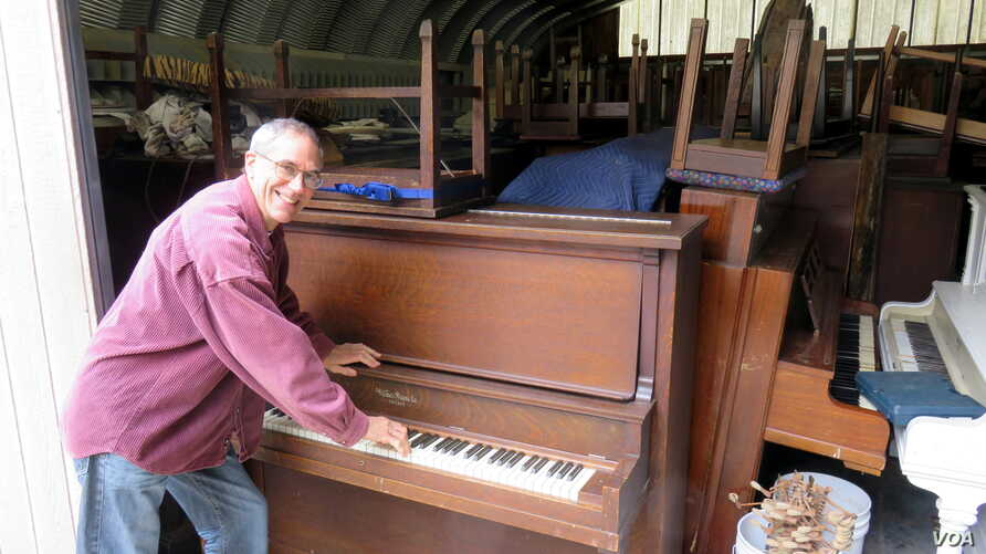 Piano tuner Dean Petrich of Freeland, Washington, gives away pianos for price of delivery to winnow his stash of more than 80 cast-off pianos.