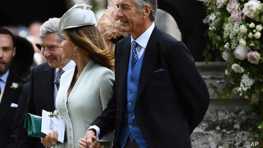FILE - David Matthews and his wife, Jane, parents of James Matthews, are pictured at their son's wedding to Pippa Middleton, the sister of Kate, Duchess of Cambridge, at St Mark's Church in Englefield, England, May 20, 2017. A source has told Reuters
