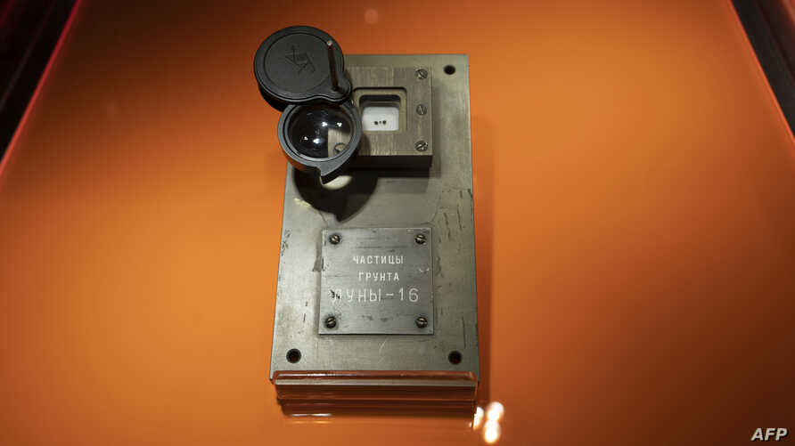 Three moon rocks returned to Earth from the unmanned Soviet Luna-16 mission in 1970 are displayed at Sotheby's in New York, Nov. 28, 2018.  The rocks sold for $855,000 in New York on Nov. 29, 2018, Sotheby's said.