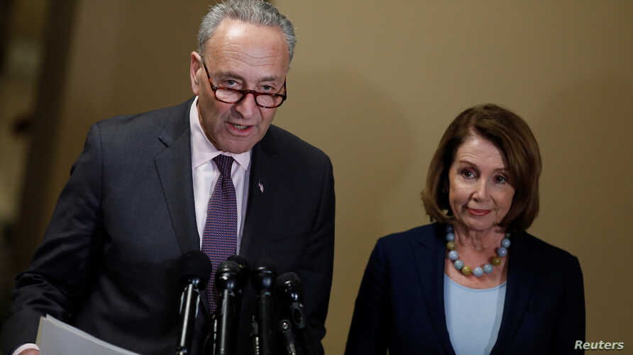 FILE - Senate Minority Leader Chuck Schumer and House Minority Leader Nancy Pelosi speak at a news conference.